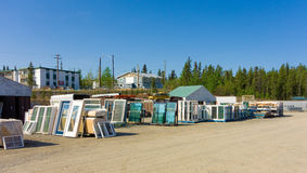 Various glass doors and windows in a commercial yard Stock Photo