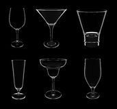 Various glasses on black Royalty Free Stock Photography