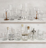 Various glassware collection on wooden shelves Royalty Free Stock Image