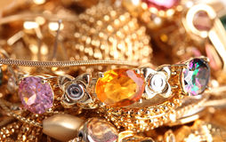 Various gold jewellery Stock Images