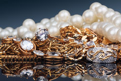 Various gold jewellery on black background Royalty Free Stock Photos