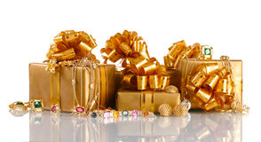 Various gold jewellery and gifts Stock Images