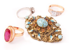 Various golden rings and antique brooch stock photography