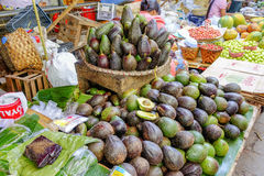 Various goods in Burmese market, Myanmar. Avocados at fruit stall in Burmese market, Myanmar. In Myanmar, eggshells are used for plants to protect plants from royalty free stock image