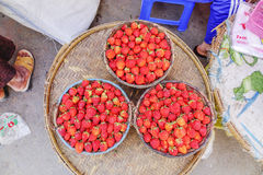 Various goods in Burmese market , Myanmar. 3 baskets of strawberry in Burmese market, Myanmar. In Myanmar, eggshells are used for plants to protect plants from stock photos