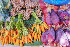 Various goods in Burmese market , Myanmar. Carrots, banana flowers, turmerics at vegetables stall in Burmese market, Myanmar. In Myanmar, eggshells are used for royalty free stock photo