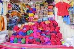 Various goods in Burmese market, Myanmar. Burmese costume stall with colorful design in Burmese market, Myanmar . Myanmar is one of the mysterious country in stock image