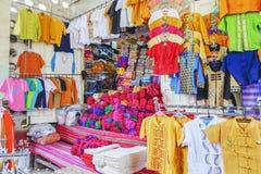 Various goods in Burmese market, Myanmar. Burmese costume stall with colorful design in Burmese market, Myanmar . Myanmar is one of the mysterious country in stock photo