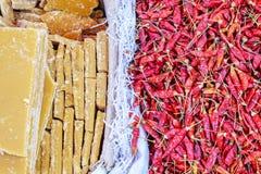 Various goods in Burmese market , Myanmar. Dried chillies bag and yellow sugar bag in Burmese market, Myanmar. In Myanmar, eggshells are used for plants to stock image