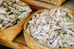 Various goods in Burmese market, Myanmar. Dried fishes in closely-woven baskets in Burmese market, Myanmar. Myanmar is one of the mysterious country in South royalty free stock photos