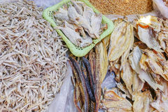 Various goods in Burmese market , Myanmar. Dried fishes, Burmese market, Myanmar. In Myanmar, eggshells are used for plants to protect plants from some insects stock photography