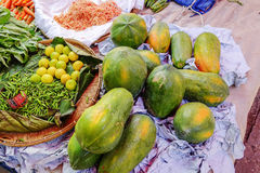 Various goods in Burmese market , Myanmar. Papayas, Burmese market, Myanmar. In Myanmar, eggshells are used for plants to protect plants from some insects, they royalty free stock images