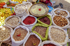 Various goods in Burmese market , Myanmar. Pea baskets in Burmese market, Myanmar. In Myanmar, eggshells are used for plants to protect plants from some insects royalty free stock images