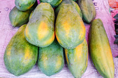 Various goods in Burmese market, Myanmar. Ripe papayas in Burmese market, Myanmar. In Myanmar, eggshells are used for plants to protect plants from some insects stock photography