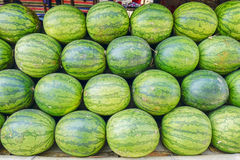Various goods in Burmese market , Myanmar. Watermelon stall in Burmese market, Myanmar. In Myanmar, eggshells are used for plants to protect plants from some stock photos