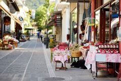 Various goods sold at small shops at the pedestrian area at center of Kalavryta town near the square and odontotos train station,. Various food and goods sold at stock images