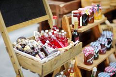 Various goods sold at small shops at the pedestrian area at center of Kalavryta town near the square and odontotos train station,. Various food and goods sold at royalty free stock image