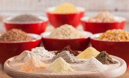 Various grains and cereals and their corresponding flours - healthy diversified diet concept. Various grains and cereals and their corresponding flours - healthy stock photo