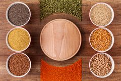 Various grains and seeds on the table and in bowls - top view royalty free stock image