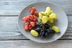 Various  grapes on a plate Stock Images