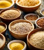 Various groats, cereals. Different types of groats in bowls, close up stock photography