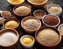 Various groats, cereals. Different types of groats in bowls, close up. royalty free stock photo