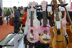 Various guitars in the musical instruments Stock Image