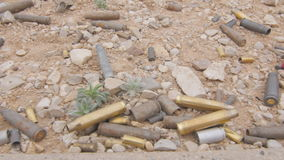 Various Gun Ammunition Shells on the Ground stock video
