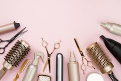 Various hair dresser tools on pink background with copy space.  stock photos