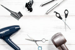 Various hair styling devices on white background, top view Royalty Free Stock Images