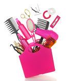 Various hairstyling equipment in shopping bag. Isolated on white Stock Photo