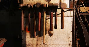 Various hammers at workshop stock footage