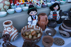 Various handicrafts fair: dolls, mugs, woodden egs Royalty Free Stock Image