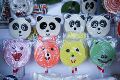 Various handicrafts fair: traditional lollipops, bear and pig models Stock Photography