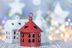 Various handmade decorations against glowing christmas lights. Background stock images
