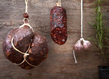 Various hanging salami sausages Royalty Free Stock Photography