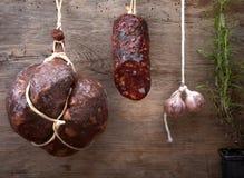 Various hanging salami sausages royalty free stock photography