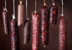 Various hanging salami sausages Stock Photo