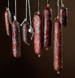 Various hanging salami sausages Stock Image