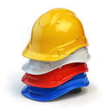 Various hard hats, safety helmets  on white. Royalty Free Stock Photography