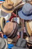 Various hats on the display at the market royalty free stock photography