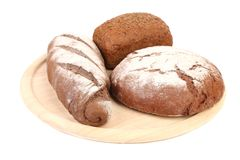 Various healthy bread on a wooden tray. Royalty Free Stock Image