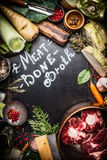 Various Healthy cooking ingredients for Meat Bone Broth with lettering on dark chalkboard Royalty Free Stock Images