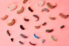 Various hearing aids on red background, alternative to surgery. ENT accessory. stock photo
