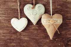 Various heart on wood Stock Images