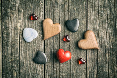 Various hearts on wooden table. Royalty Free Stock Images