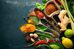 Various herbs and spices. On black stone plate stock images