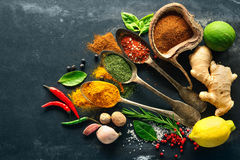 Various herbs and spices. On black stone plate stock photos
