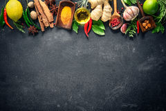Various herbs and spices. On black stone plate royalty free stock photography