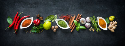 Various herbs and spices. On dark background stock images